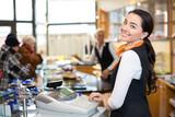 Salesperson at cash register - 61555360