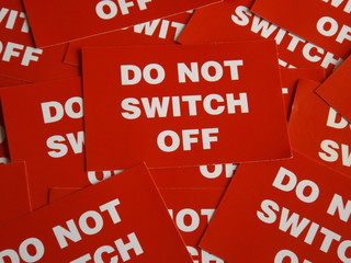 Background of DO NOT SWITCH OFF signs