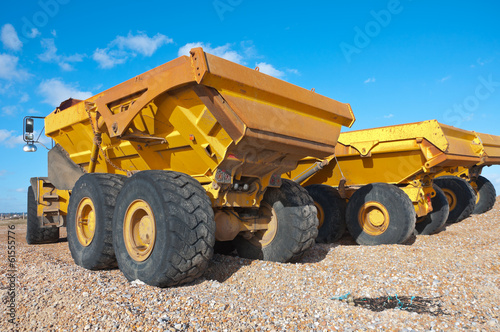 dumper trucks on a beach