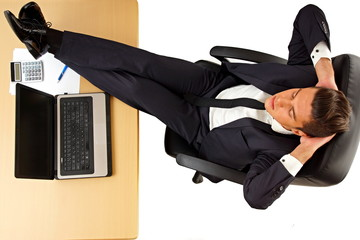 Young businessman at suit and tie relaxing in work