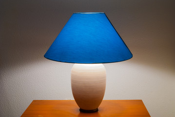 Lit bedside lamp over nightstand