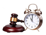 Judge gavel and Alarm Clock isolated on white background