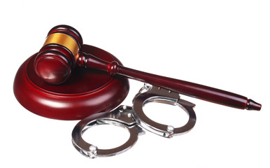 Handcuffs and Judge Gavel isolated on white