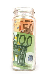 Euro Banknotes in glassy jar isolated in white