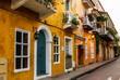 Typical street scene in Cartagena, Colombia of a street with old - 61557116