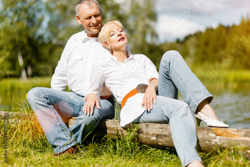 Happy senior couple outdoors in spring