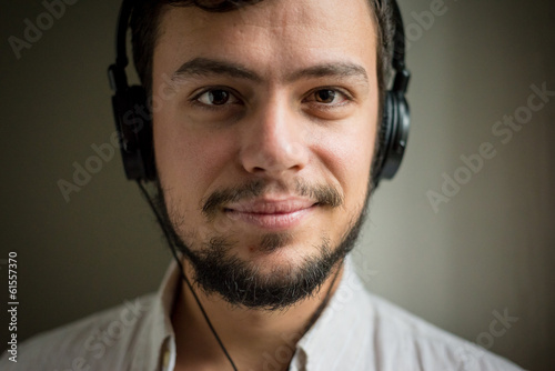 young stylish man lifestyle listening to music