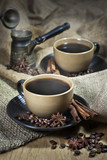 Two cups of coffee with spices and old cezve