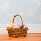 Basket easter eggs in room with blue vintage wall paper
