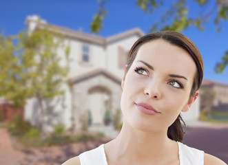 Thoughtful Mixed Race Woman In Front of House