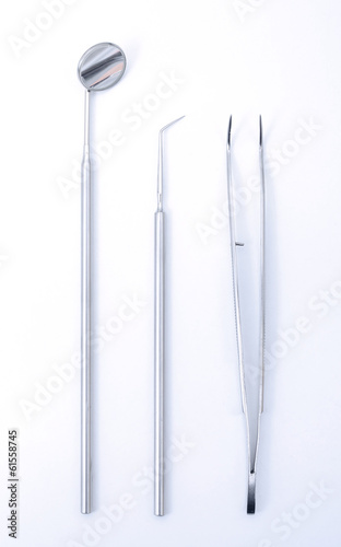 Row of various dental tools on white