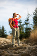 Pretty, female hiker going downhill in warm evening light