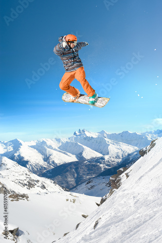 Extreme snowboarding man jumping high in the air