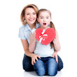 happy mother and young daughter hold gift for birthday