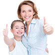 Mother and young daughter with thumbs up