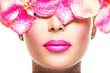 face of  woman with bright lipstick on a lips and pink flowers