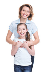 Full portrait of happy mother and young daughter