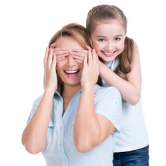 Young daughter closes hands eyes mom