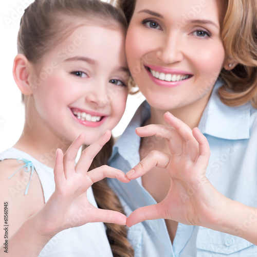 mother and young daughter with heart shape sign