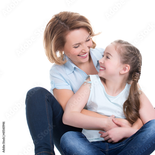 Portrait of smiling mother and young daughter