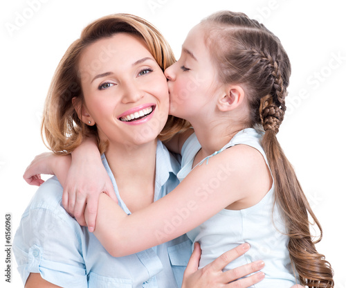 young daughter  kissing mother