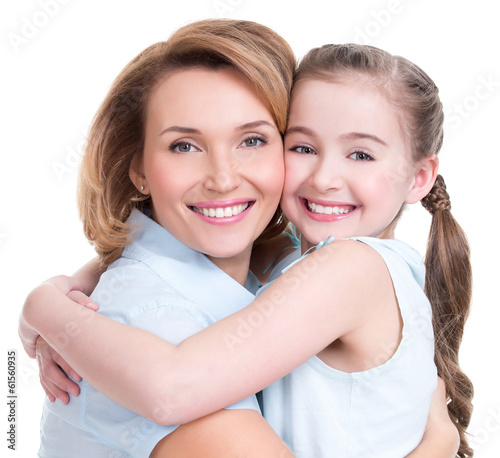 Closeup portrait of happy mother and young daughter