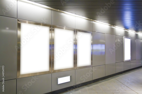 Blank billboard in metro station