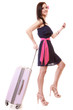 Girl tourist in dress walking with suitcase. Travel tourism.