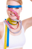 Obsessed fit woman with measure tapes. Time for diet slimming.