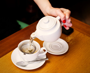 pouring tea on table