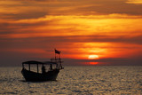 Amazing view of fishing boat at sunset in Cambodia