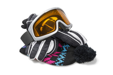 Ski gloves, cap and goggles isolated with clipping path.