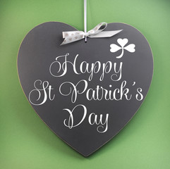 Happy St Patricks Day greeting message on heart blackboard
