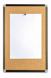closeup of blank note paper on cork board