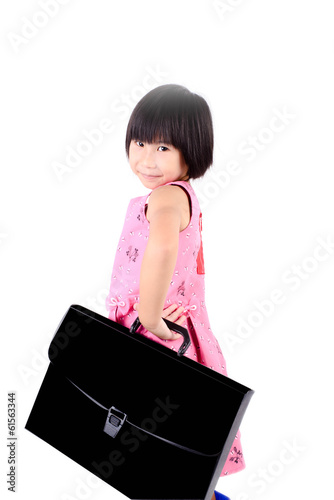 Little girl in pink dress with briefcase isolated on white backg