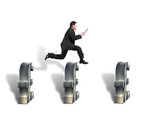 Businessman jumping over 3d pound symbols