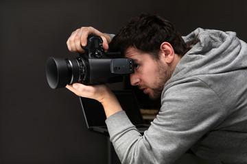 Portrait photographer with modern digital camera