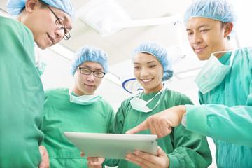 happy Surgeons discussing success operating procedure