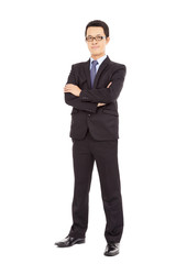 Confident businessman standing arms crossed