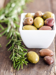 Bowl filled with fresh green olives