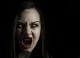 Bloodthirsty female vampire with angry expression