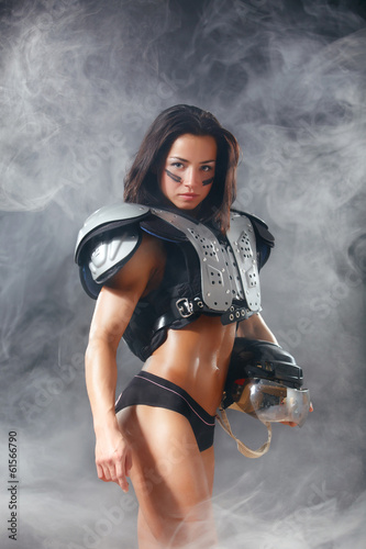 American footbal quarterback beautiful girl with a helmet in the