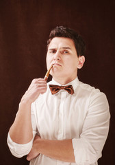 attractive vintage stylish man with tobacco pipe