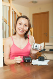 girl unpacking new compact digital camera