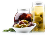 Tasty olives in glass jars, isolated on white