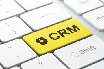 Business concept: Head With Padlock and CRM on computer keyboard
