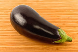 eggplant isolated on wooden background