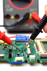 engineer is checking electronic component