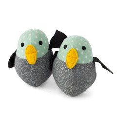 Two handmade textile toy birds isolated on white
