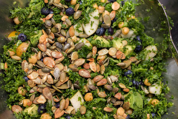 Kale salad in silver salad bowl  full frame